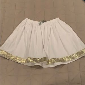 $12 or 2/$20 Crewcuts white skirt with gold trim